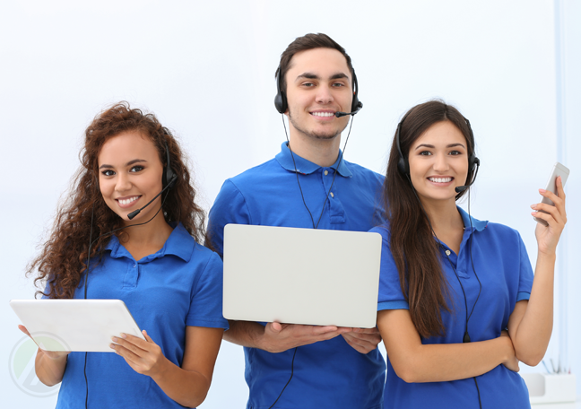 custmomer service team in blue uniforms headsets using laptop tablet smartphone