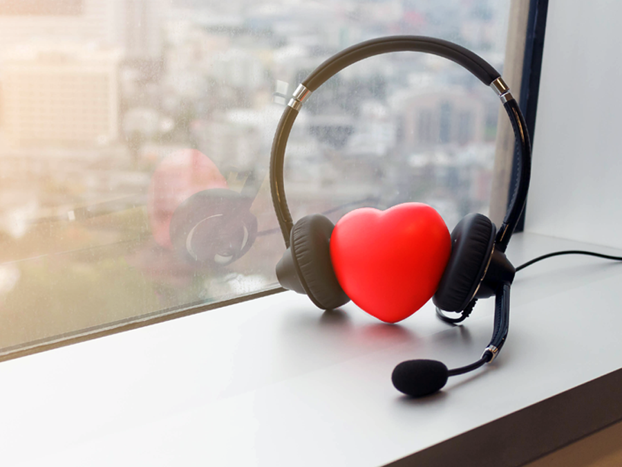 red heart wearing call center headset by a window