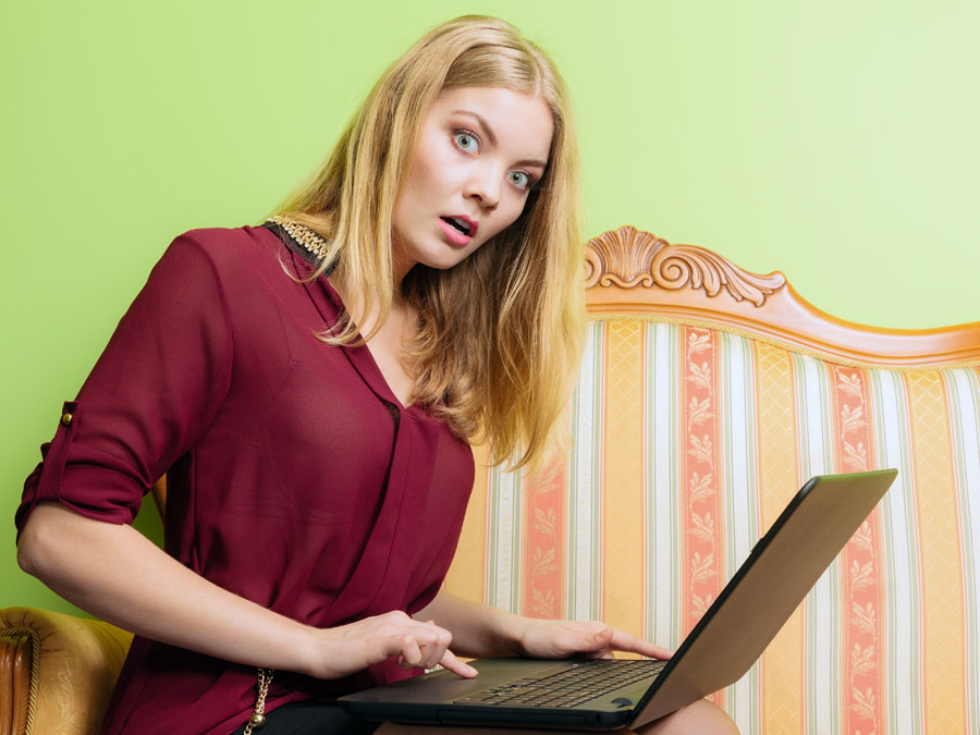 surprised disappointed business executive using laptop