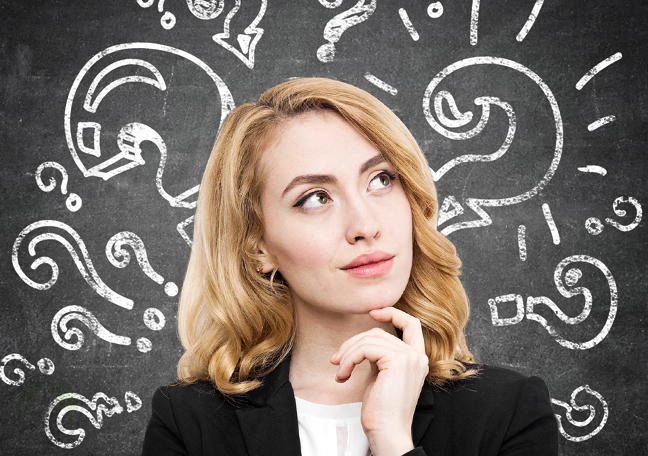 thinking business woman with blackboard backdrop with question mark chalk