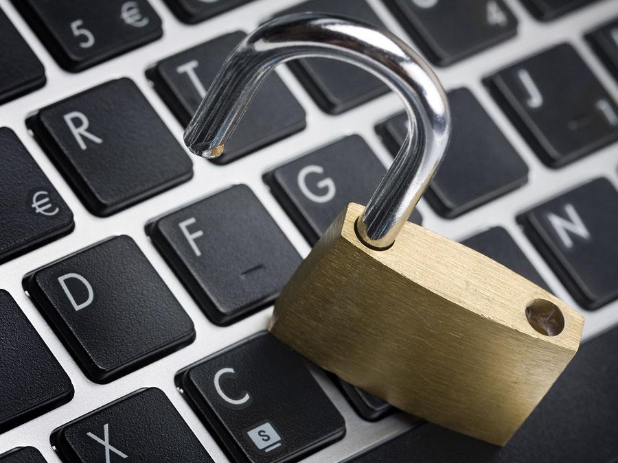 unlocked open padlock on laptop keyboard