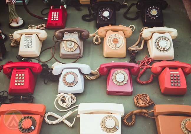 vintage landline telephones on the floor