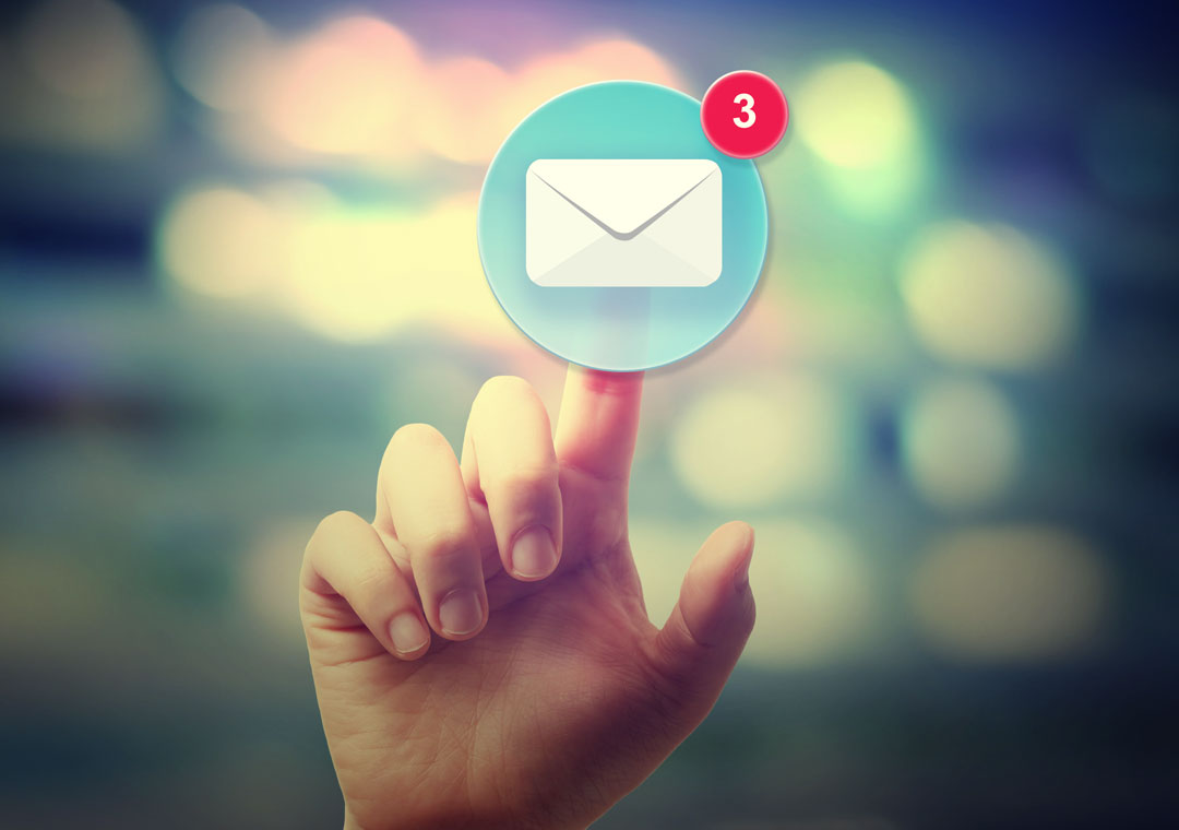 customer support agent hand tapping on email support envelope icon