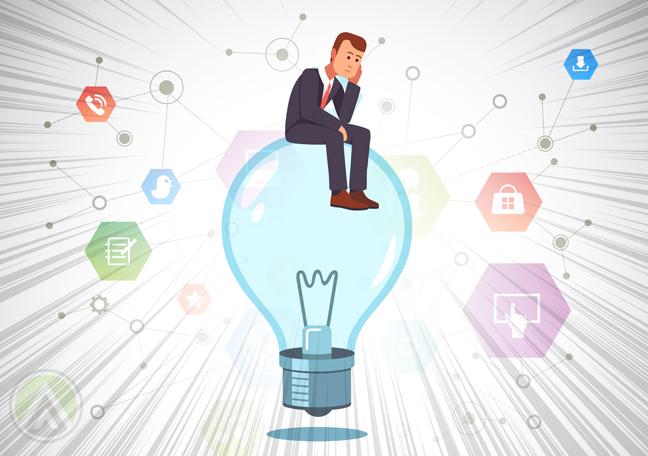 thinking businessman sitting on light bulb