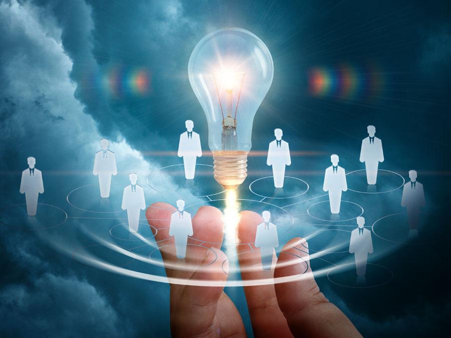 virtual recruitment employee group around lightbulb idea under hand