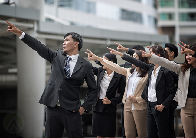 group of asian business executives professionals pointing to sky