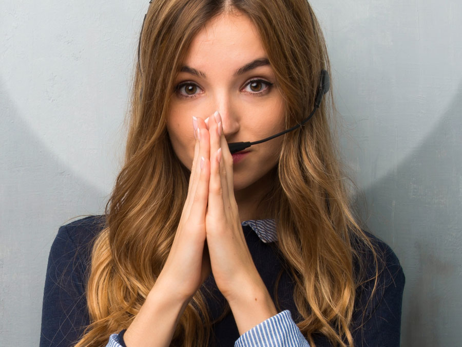 apologetic call center agent hands covering mouth