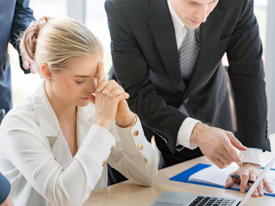 frustrated business executive with company team reviewing figures