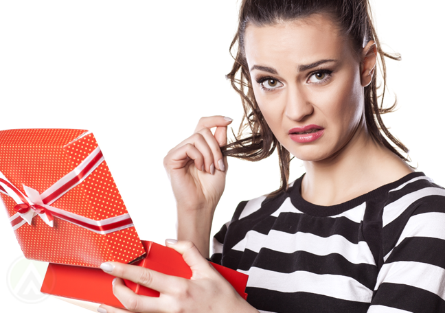 disappointed office worker woman holding gift box