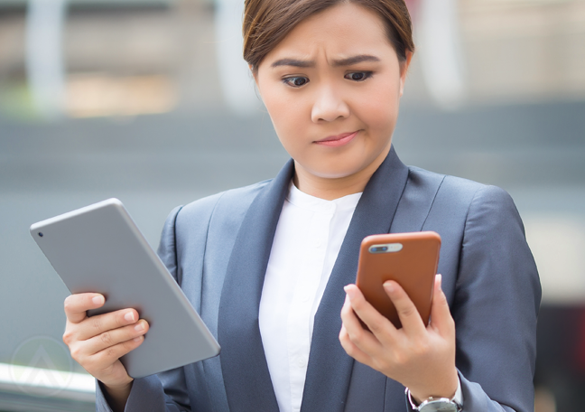 disappointed business woman holding smartphone tablet