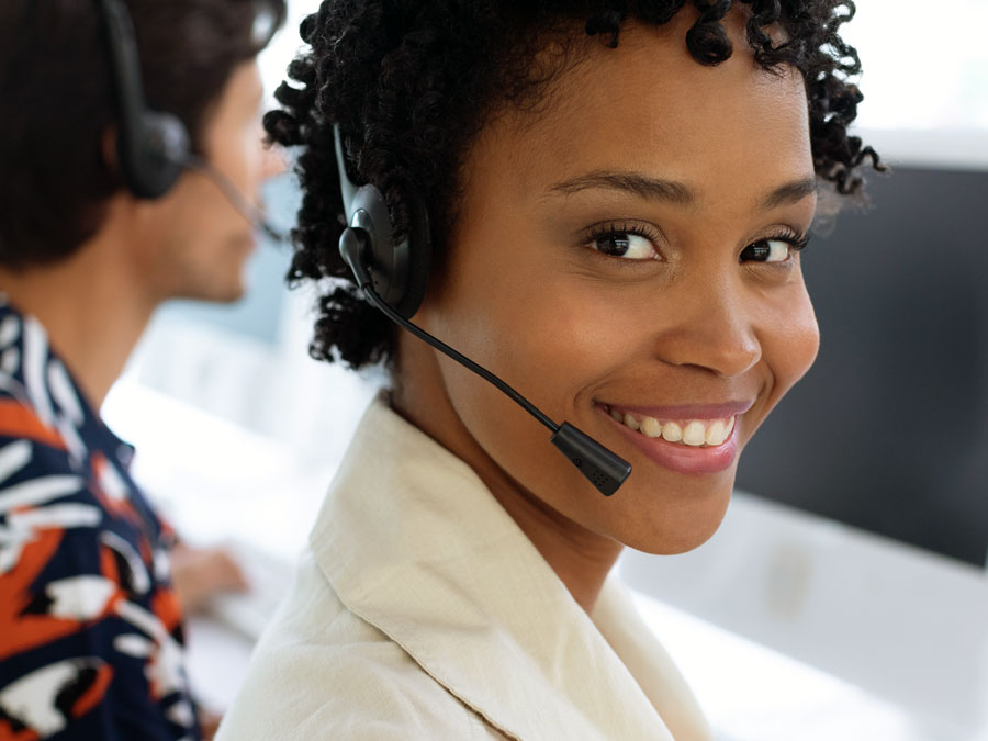 smiling customer service agent in call center