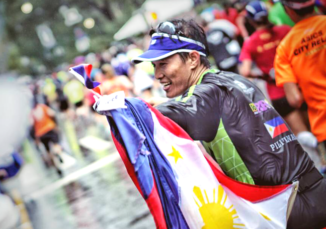 Open Access's BPO Leo Penas at the finish line of the NYC Marathon with Philippine flag