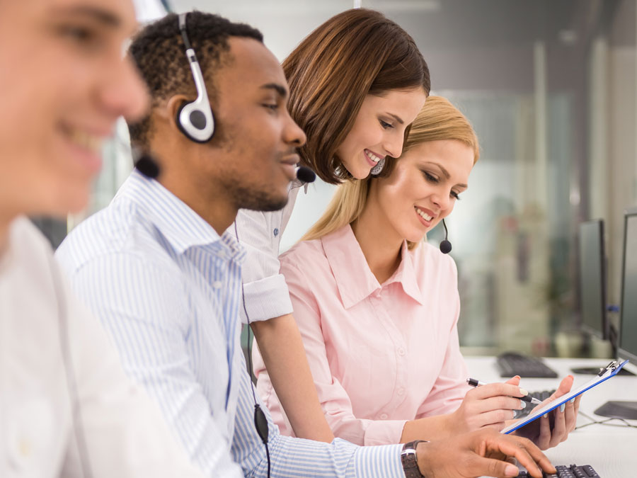 call center team leader helping customer service agents