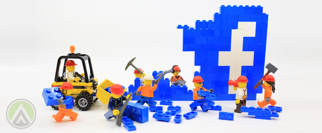 Lego minifigs wrecking down facebook wall