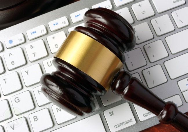 gavel on computer keyboard