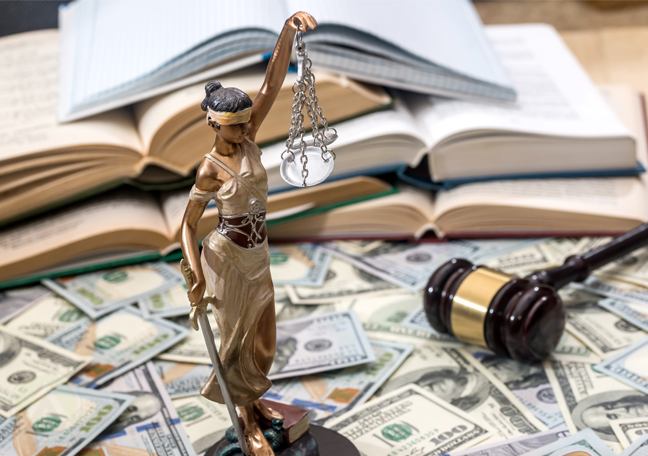 lady justice statue judge gavel law books over pile of cash