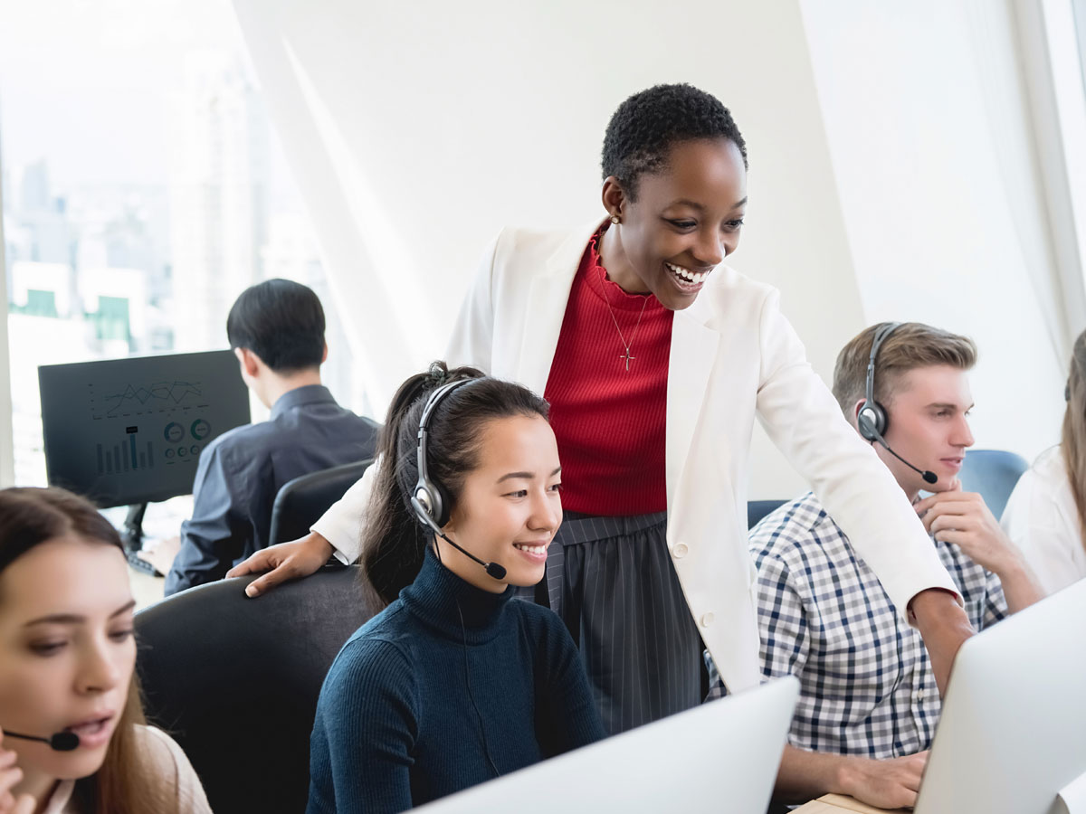 call center team leader helping diverse customer support team