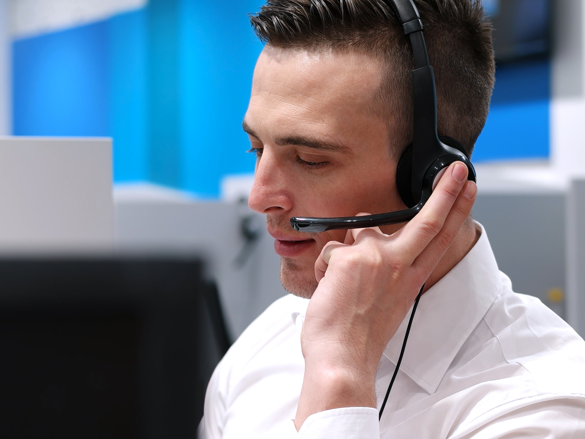 male call center rep busy attending to customer call_Open-Access-BPO