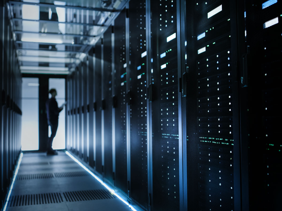 IT manager inspecting server in datacenter