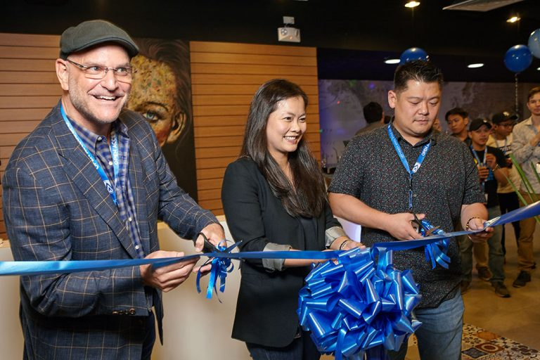 Open Access BPO executives cut ribbon to launch new office