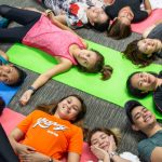 Open Access BPO yoga pilates participants taking a break
