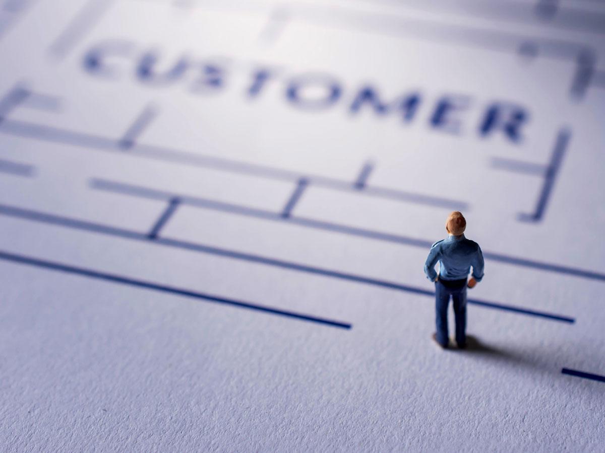tiny figure standing outside customer maze