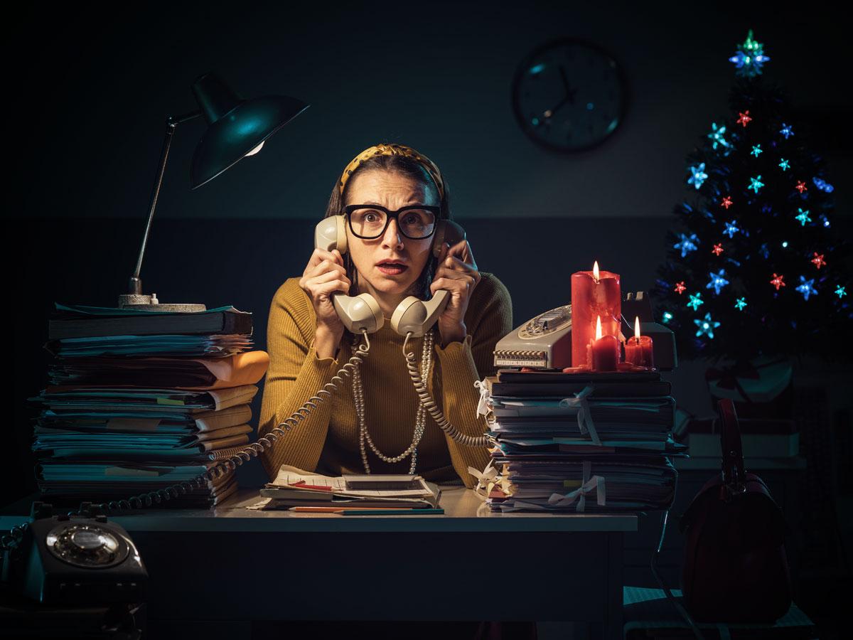 e-commerce entrepreneur on phones in dark office