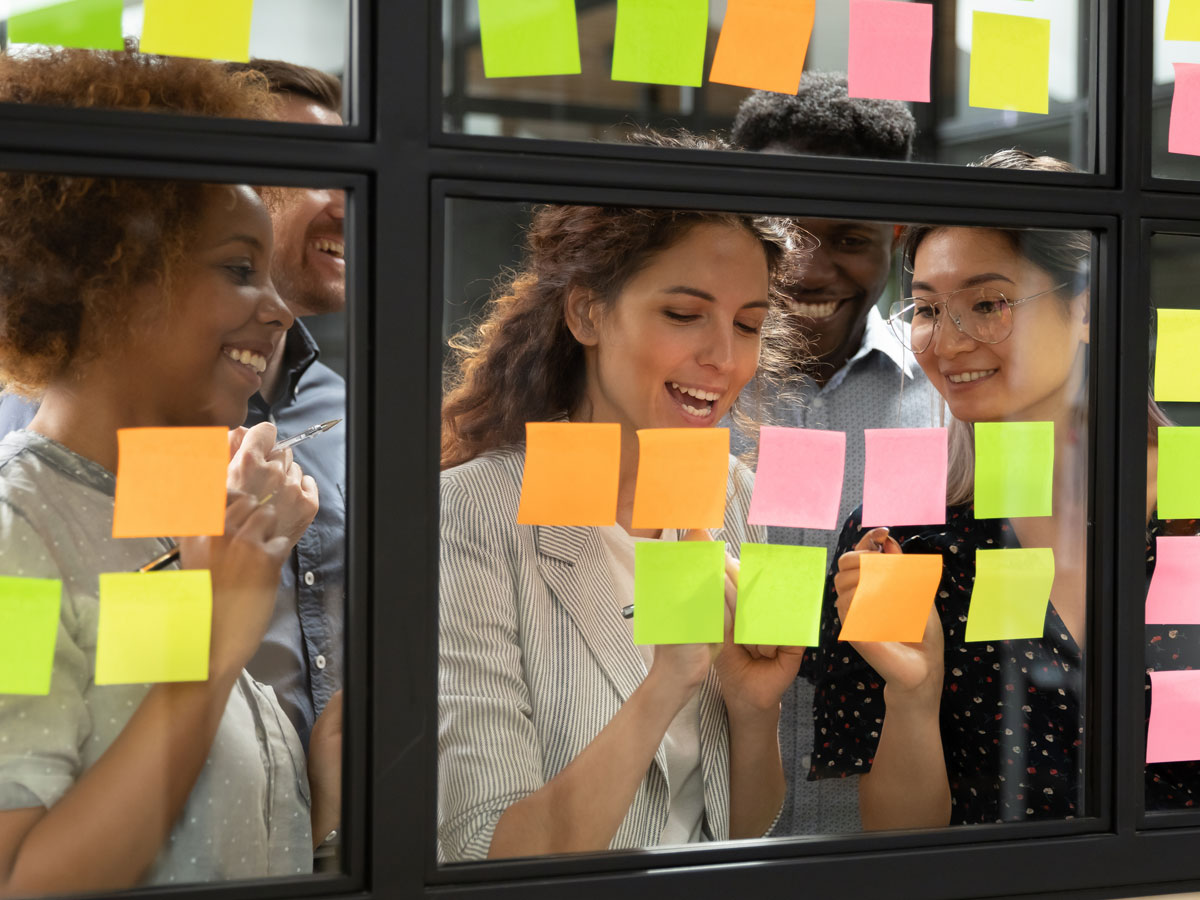 happy e-commerce team looking at post it notes