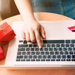 consumer hands online shopping e-commerce on laptop