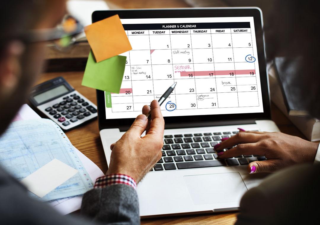 call center team leader working on customer service agent schedule on calendar